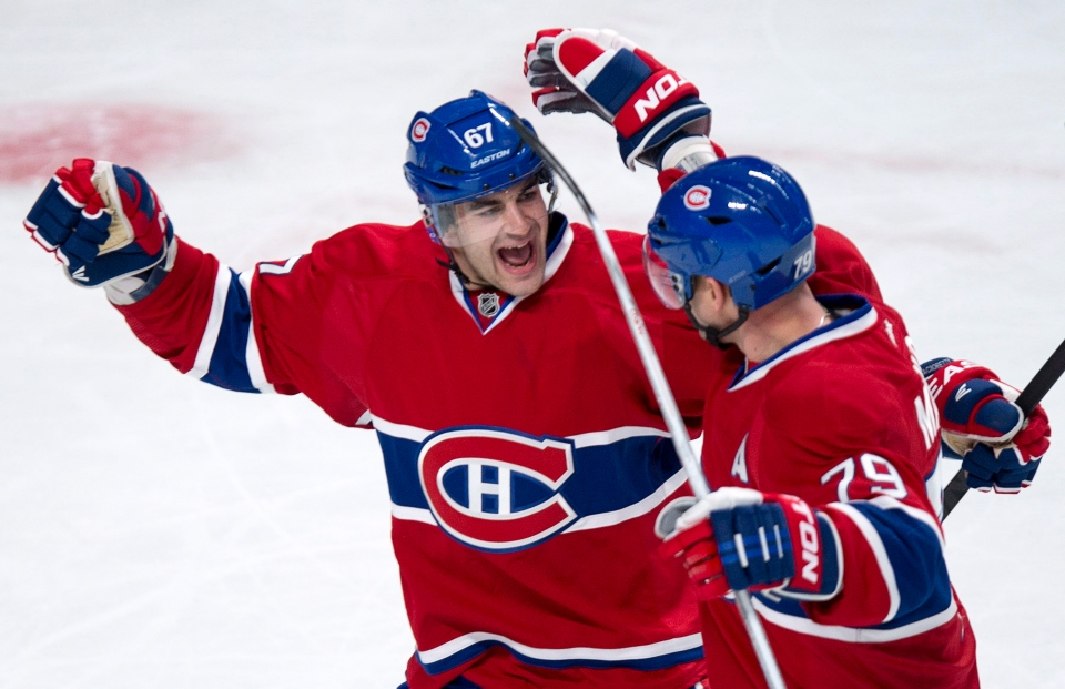 Montreal Canadiens' Max Pacioretty, left, congratulates teammates Andrei Markov for his power play goal against the Florida Panthers during first period NHL hockey action in Montreal on Tuesday, January 22, 2013. (Paul Chiasson / THE CANADIAN PRESS)
