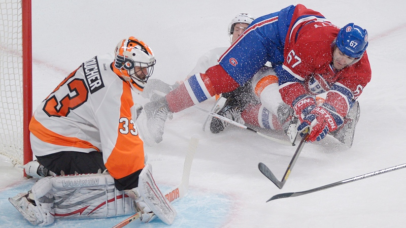 Montreal Canadiens' Max Pacioretty (67) was cut by the skate of Philadelphia Flyers' Kimmo Timonen (44) while turning towards Flyers' goaltender Brian Boucher's net during third period NHL hockey action in Montreal, Saturday, February 16, 2013. THE CANADIAN PRESS /Graham Hughes.