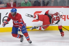 Montreal Canadiens' P.K. Subban, left, avoids a ch