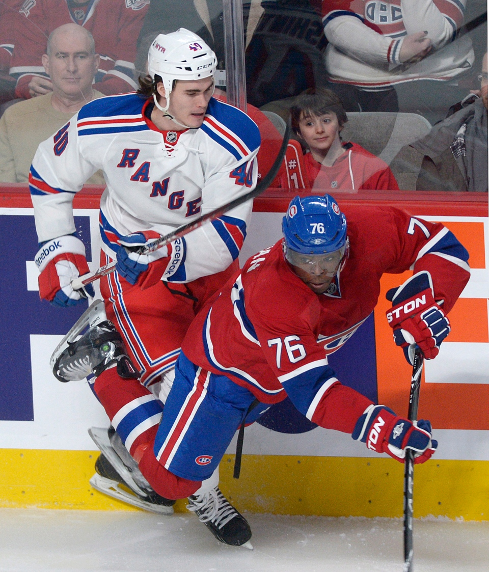 Montreal Canadiens' P.K. Subban (76) collides with New York Rangers' Brandon Mashinter during first period NHL hockey action in Montreal, Saturday, February 23, 2013. THE CANADIAN PRESS /Graham Hughes.