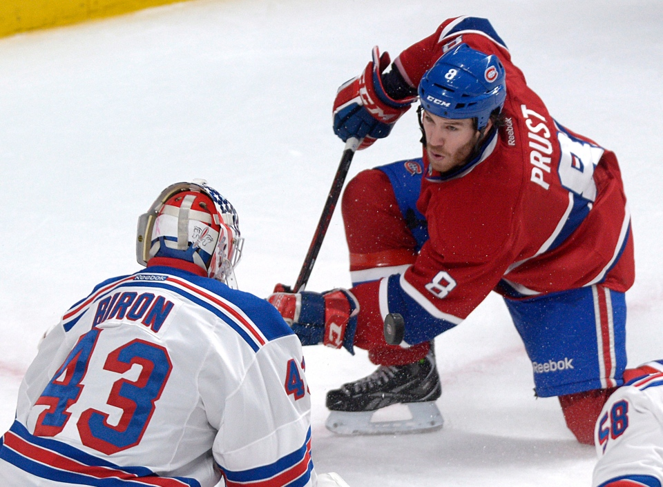 Montreal Canadiens' Brandon Prust, right, takes a shot at New York Rangers goaltender Martin Biron during first period NHL hockey action in Montreal, Saturday, February 23, 2013. THE CANADIAN PRESS /Graham Hughes