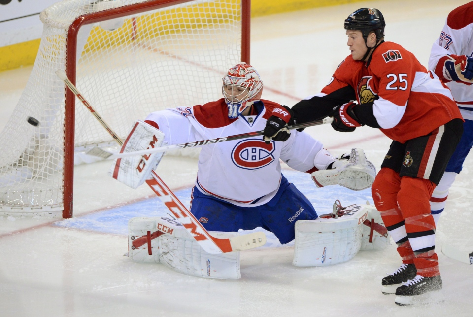 Montreal Canadiens' Carey Price deflects a shot as Ottawa Senators' Chris Neil skates in front of the net during first period NHL hockey action at the Scotiabank in Ottawa on Monday, Feb. 25, 2013. THE CANADIAN PRESS/Sean Kilpatrick