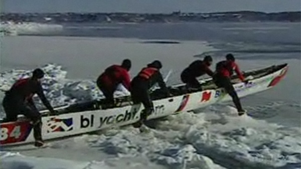 An ice canoe team prepares to head into the St. Lawrence River. (Jan. 24, 2011)