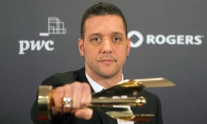 George Stroumboulopoulos celebrates his award for Best Host in a Variety, Lifestyle, Reality/Competition, Performimg Arts or Talk Program at the Canadian Screen Awards in Toronto on Sunday, March 3, 2013. (Chris Young / THE CANADIAN PRESS)