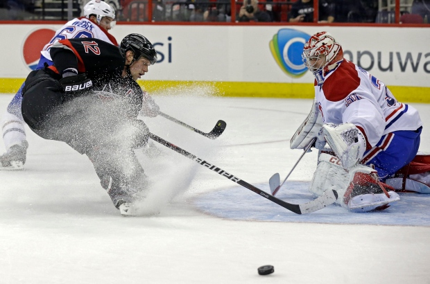 Carolina Hurricanes' Eric Staal (12) shoots while