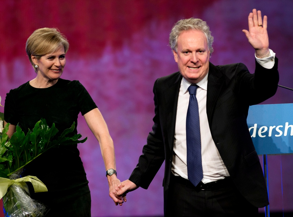 Quebec Liberal Party leader Jean Charest and his wife, Michele Dionne, wave to the crowd after a tribute in his honour at the party's convention Saturday, March 16, 2013 in Montreal. (Ryan Remiorz / THE CANADIAN PRESS)