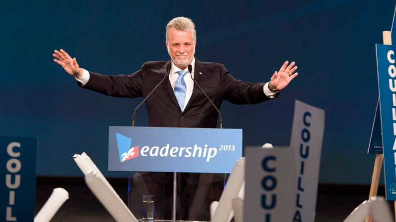 Quebec Liberal Party leadership candidate Philippe Couillard waves to delegates after his speech at the party's convention Sunday, March 17, 2013 in Montreal. THE CANADIAN PRESS/Ryan Remiorz
