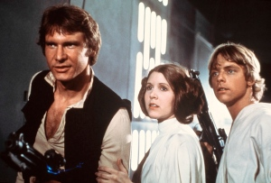 Harrison Ford, Carrie Fisher, and Mark Hamill in a scene from 'Star Wars' (20th Century-Fox Film Corporation)