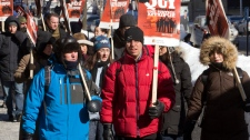 Quebec Crown prosecutors brave the -15C temperatures as they walk the picket line at the courthouse Tuesday, February 15, 2011, in Montreal. The strike to press their demands for wage and staffing increases is in its second week.THE CANADIAN PRESS/Ryan Remiorz