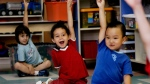 Children put up their hands for ice cream at a daycare centre in Montreal on Friday, August 18, 2006.  THE CANADIAN PRESS/Ian Barrett