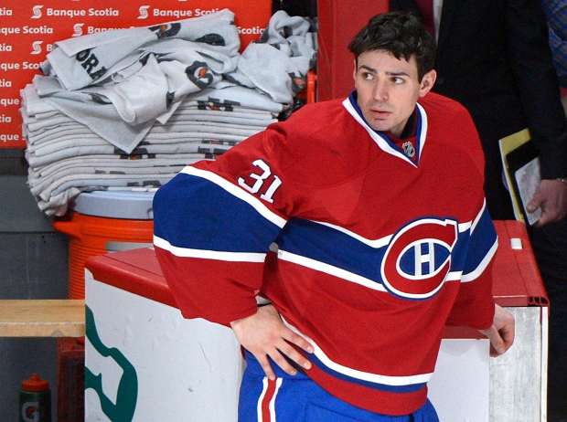 Montreal Canadiens goaltender Carey Price looks on from the bench following a NHL hockey game against the Washington Capitals in Montreal, Saturday, April 20, 2013. The Capitals won the game 5-1.THE CANADIAN PRESS/Graham Hughes.