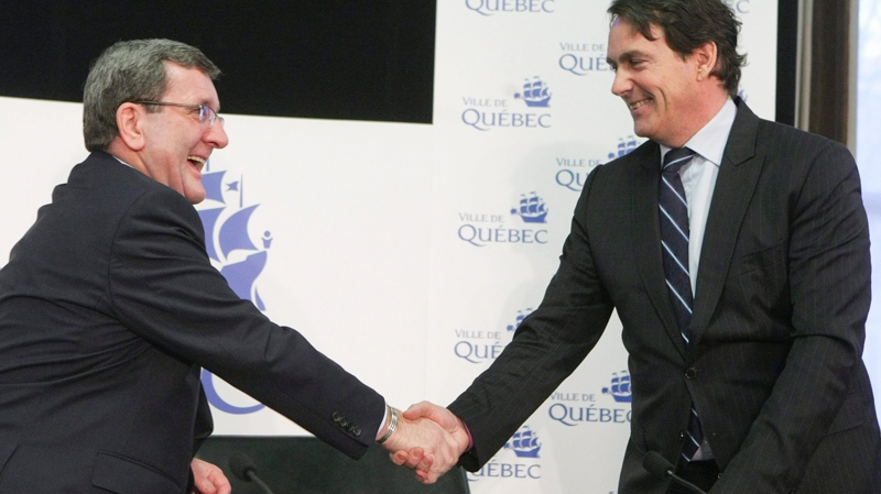 Quebec city mayor Regis Labeaume, left, and Pierre-Karl Peladeau, CEO of Quebecor, shake hands after a press conference at city hall in Quebec City, Tuesday March 1, 2011. Paladeau and Labeaume discussed the details of Quebecor investment as private partner in a new arena. (Francis Vachon / THE CANADIAN PRESS)