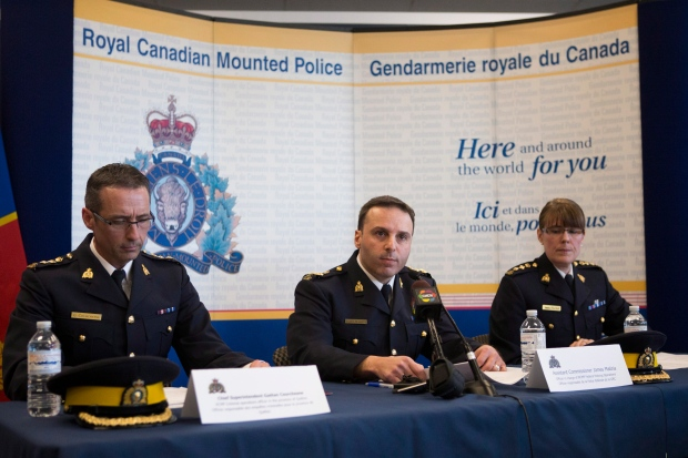 RCMP Assistant Commissioner James Maliza, centre, is flanked by Chief Supt. Gaetan Courchesne, left, and Chief Supt. Jennifer Strachan at a news conference in Toronto on Monday, April 22, 2013, as the RCMP announce the arrest of two men accused of plotting a terror attack. (The Canadian Press/Chris Young)
