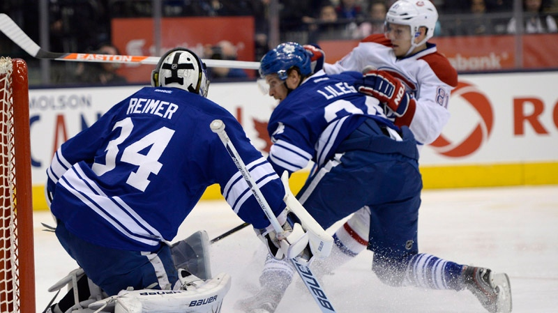 Montreal Canadiens centre, 81, drives for the net as Toronto Maple Leafs' John-Michael Liles, 24, defends and goalie James Reimer watches for the puck during first period NHL action in Toronto on Saturday April 27, 2013. THE CANADIAN PRESS/Frank Gunn