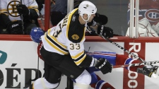 Montreal Canadiens' Max Pacioretty is hit by Boston Bruins' Zdeno Chara during second period NHL hockey action Tuesday, March 8, 2011 in Montreal. (THE CANADIAN PRESS/Paul Chiasson)