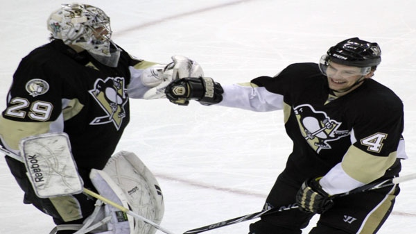 Pittsburgh Penguins' Zbynek Michalek (4) is congratulated by goalie Marc-Andre Fleury after scoring a goal in the third period of an NHL hockey game on Sunday, March 13, 2011, in Pittsburgh. The Penguins won 5-1. (AP Photo/Keith Srakocic)