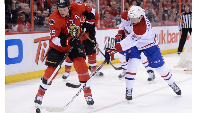 Ottawa Senators' Chris Neil fights for the puck against Montreal Canadiens' Alex Galchenyuk during the first period of game four of first round NHL Stanley Cup playoff hockey in Ottawa on Tuesday, May 7, 2013. THE CANADIAN PRESS/Sean Kilpatrick