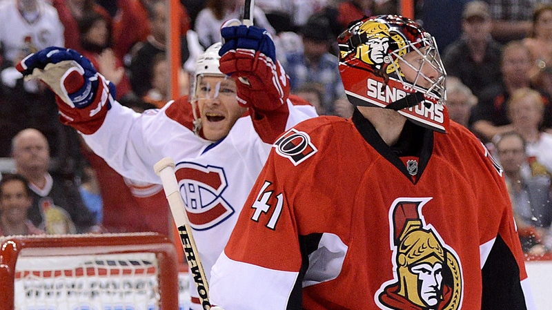 Ottawa Senators' Craig Anderson looks up ice as Montreal Canadiens' Jeff Halpern celebrates teammate Alex Galchenyuk's second goal during game four of first round NHL Stanley Cup playoff hockey at the Scotiabank Place in Ottawa on Tuesday, May 7, 2013. THE CANADIAN PRESS/Sean Kilpatrick