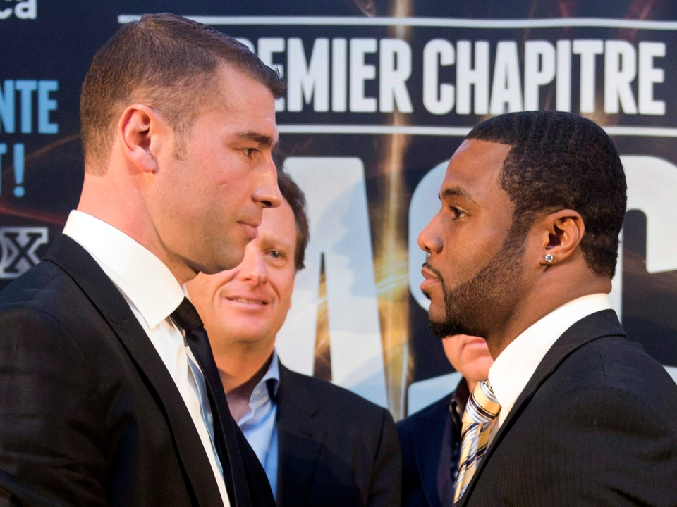 Lucien Bute, left, and Jean Pascal face off after their news conference Tuesday, March 26, 2013 in Montreal. The two Quebec boxers will face each other May 25, 2013 at the Bell Center.THE CANADIAN PRESS/Ryan Remiorz