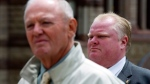 Toronto Mayor Rob Ford (right) stands behind deputy mayor Doug Holyday at City Hall in Toronto, on Friday May 17, 2013. (Frank Gunn / THE CANADIAN PRESS)