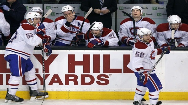 Montreal Canadiens players react on the bench after a goal by the Boston Bruins during the third period of an NHL hockey game in Boston Thursday, March 24, 2011. The Bruins won 7-0. (AP Photo/Elise Amendola)