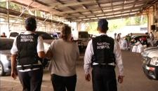 Pamela Porter in handcuffs