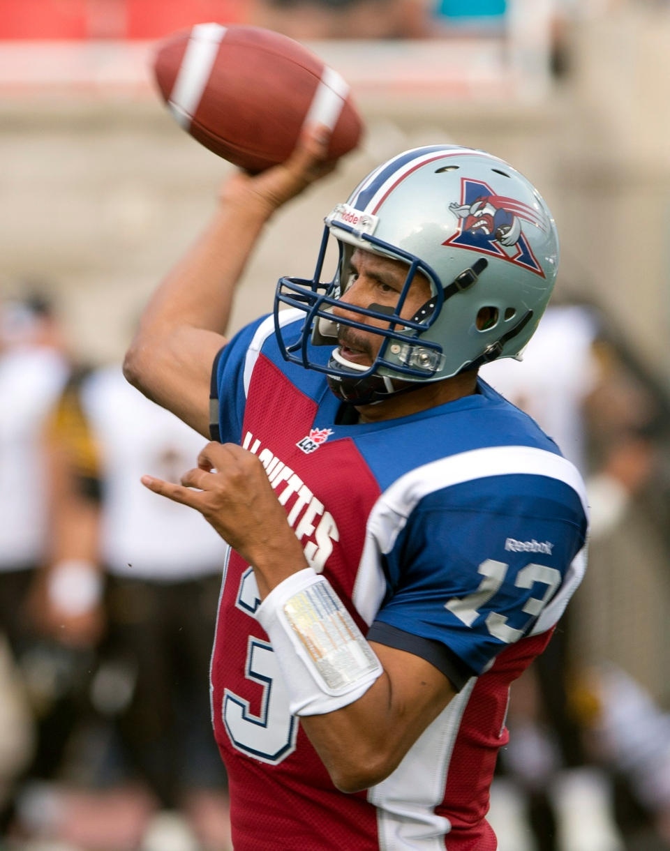 Montreal Alouettes quarterback Anthony Calvillo throws a pass during first quarter Canadian Football League pre-season action against the Hamilton Tigercats Thursday, June 13, 2013 in Montreal. THE CANADIAN PRESS/Ryan Remiorz
