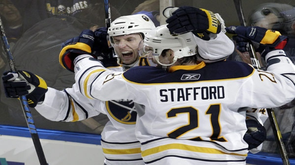 Buffalo Sabres' Thomas Vanek, left, of Austria, celebrates his goal with teammate Drew Stafford (21) in overtime of an NHL hockey game against the Philadelphia Flyers in Buffalo, N.Y., Friday, April 8, 2011. The Sabres won 4-3. (AP Photo/David Duprey)