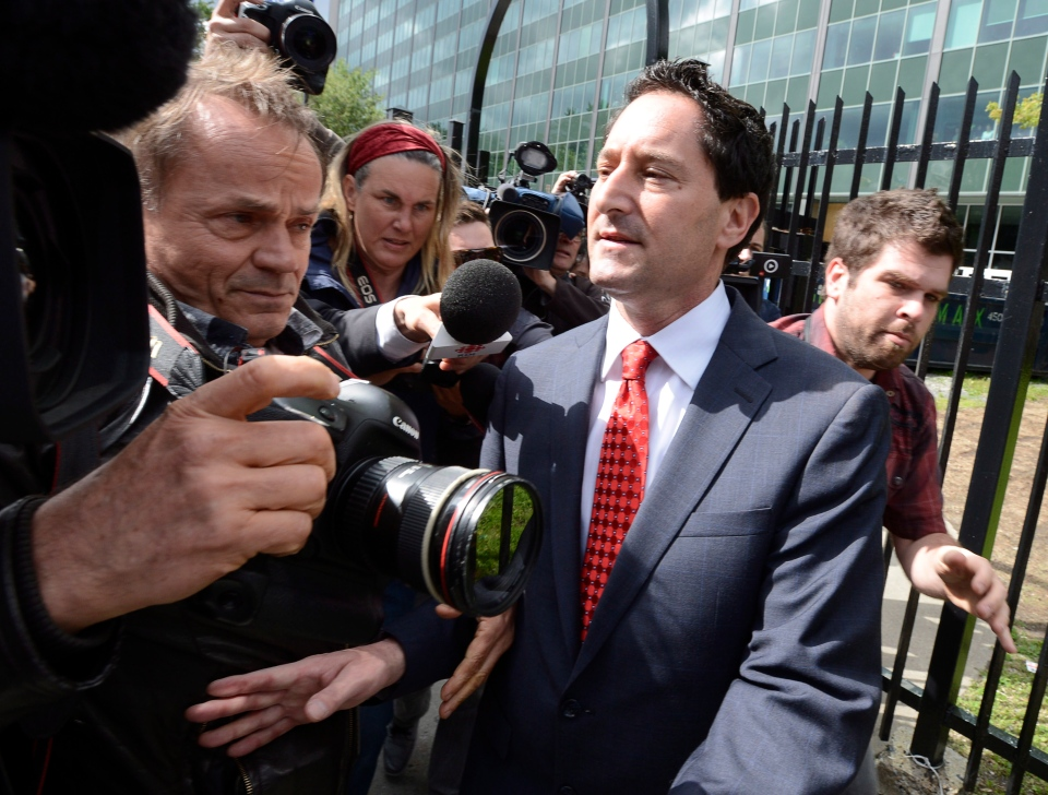 Montreal Mayor Michael Applebaum moves past members of the media outside police headquarters in Montreal, Monday, June 17, 2013. Applebaum was arrested earlier as part of a bribery case. THE CANADIAN PRESS/Ryan Remiorz