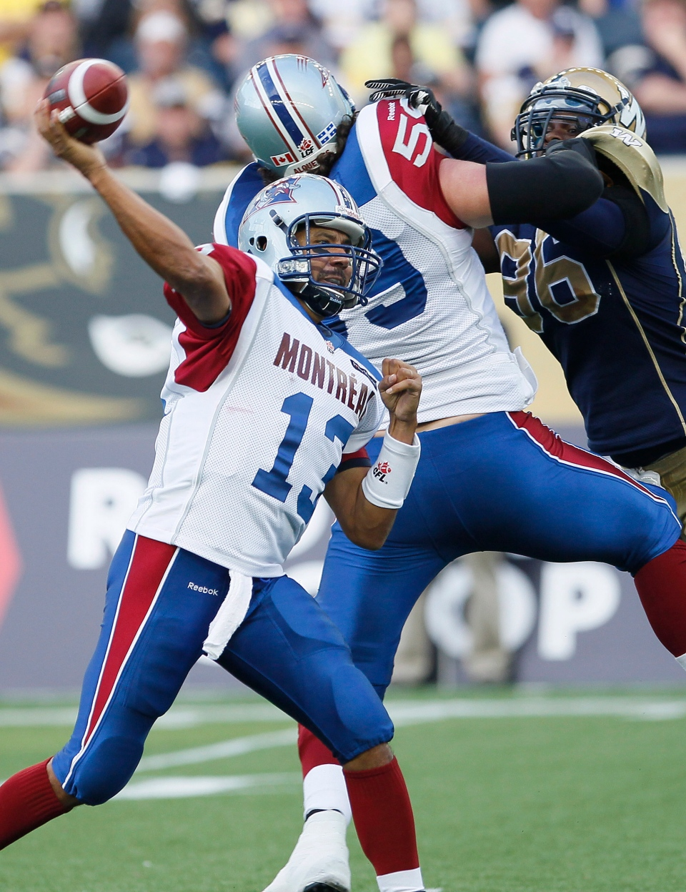 Montreal Alouettes quarterback Anthony Calvillo (13) throws against the Winnipeg Blue Bombers during the first half of their CFL game at Investors Group Field in Winnipeg Thursday, June 27, 2013. THE CANADIAN PRESS/John Woods
