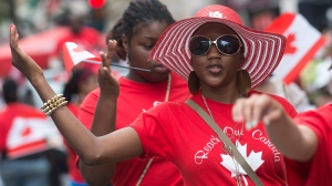 A member of Reach Out Canada performs during the annual Canada Day parade in Montreal, Monday, July 1, 2013. THE CANADIAN PRESS/Graham Hughes