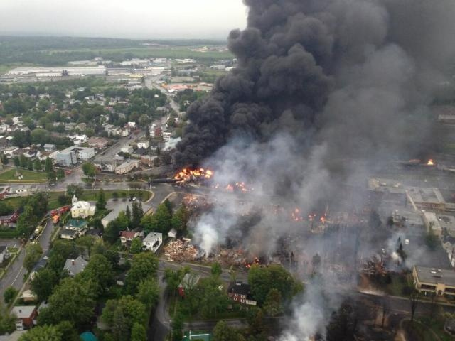 A massive fire sparked by the derailment of a train carrying crude oil is still burning in the eastern Quebec town of Lac-Megantic Saturday, July 6, 2013. (Surete du Quebec) A massive fire sparked by the derailment of a train carrying crude oil is shown burning in the eastern Quebec town of Lac-Megantic Saturday, July 6, 2013. (Surete du Quebec)