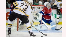 Boston Bruins' Michael Ryder (73) scores on Montreal Canadiens' goaltender Carey Price during overtime Game 4 NHL Stanley Cup playoff hockey action in Montreal, Thursday, April 21, 2011. THE CANADIAN PRESS/Graham Hughes