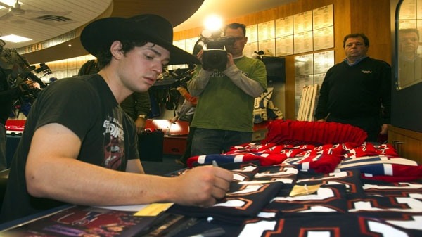 Montreal Canadiens goaltender Carey Price autographs souveniers at the end of season media availability Thursday, April 28, 2011 in Brossard, Que., after losing their NHL Stanley Cup playoff first round series to the Boston Bruins in seven gamesl.THE CANADIAN PRESS/Ryan Remiorz