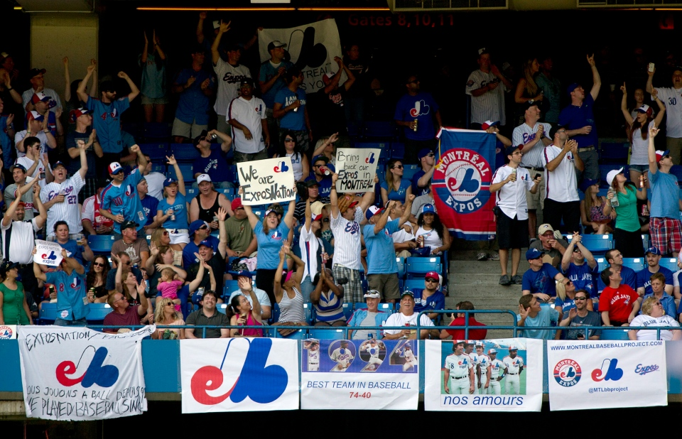 Montreal Expos fans fill an outfield section during AL action between the Toronto Blue Jays and the Tampa Bay Rays in Toronto on Saturday, July 20, 2013.  (Frank Gunn / THE CANADIAN PRESS)