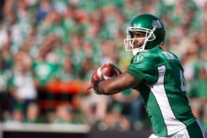 Saskatchewan Roughriders quarterback Darian Durant looks to make a pass against the Hamilton Tiger-Cats during the first half of CFL football action at Mosaic Stadium on Sunday, July 21, 2013 in Regina. (Liam Richards / THE CANADIAN PRESS)