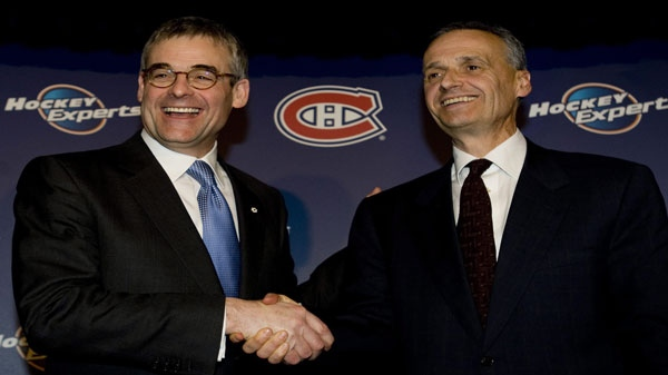 Montreal Canadiens' president Pierre Boivin, left, congratulates Pierre Gauthier on his appointment as general manager of the Canadiens at a news conference in Montreal, Monday, Feb. 8, 2010. THE CANADIAN PRESS/Graham Hughes