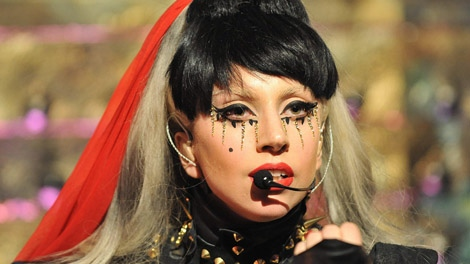 Lady Gaga can afford many more colourful wigs with the $300,000 she received from Loto-Quebec. (Photo/Nick Ansell/PA Wire)