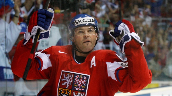 Jaromir Jagr celebrates after scoring a hat trick against the U.S. during the Hockey World Championships. May 11, 2011. (AP Photo/Petr David Josek)