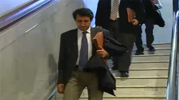 Quebec Solidaire MNA Amir Khadir exits a meeting with Quebec City Mayor Regis Labeaume on Thursday.