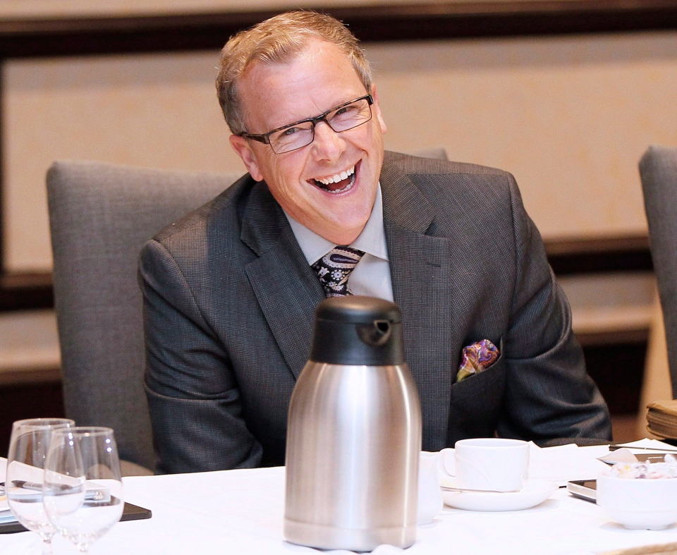 Saskatchewan Premier Brad Wall jokes with Alberta Premier Alison Redford at the 2013 Western Premier's Conference in Winnipeg, Monday, June 17, 2013. (John Woods / THE CANADIAN PRESS)