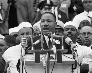 "- In this Aug. 28, 1963, black-and-white file photo, Dr. Martin Luther King Jr., head of the Southern Christian Leadership Conference, addresses marchers during his ""I Have a Dream"" speech at the Lincoln Memorial in Washington. (AP /File)"
