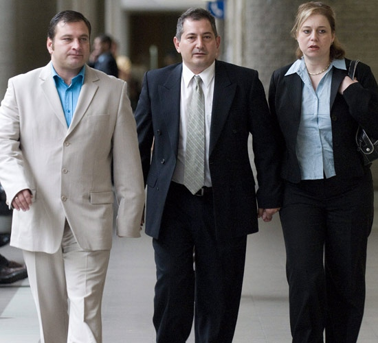 Basil Parasiris, centre, his wife Penny and brother Nick on the left enter a courtroom in Longueuil, Que., Tuesday June 3, 2008. (Peter McCabe / THE CANADIAN PRESS)