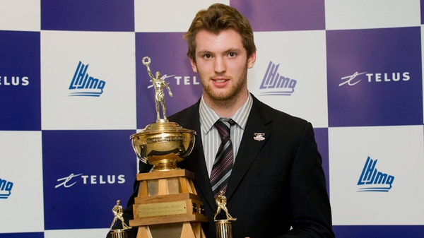 Sean Couturier with the Drummondville Voltigeurs holds the Michael Bossy Trophy for best professional prospect at the QMJHL awards ceremony in Montreal, Wednesday, April 6, 2011. The CANADIAN PRESS/Graham Hughes
