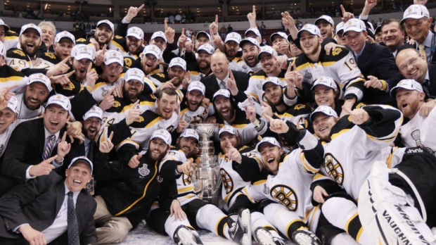 The Boston Bruins pose for a team photo as they celebrate their win over the Vancouver Canucks in game 7 of NHL Stanley Cup Final hockey at Rogers Arena in Vancouver, Wednesday, June 15, 2011. (Jonathan Hayward / THE CANADIAN PRESS)