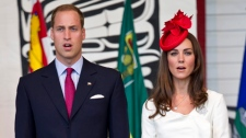The Duke and Duchess of Cambridge sing God Save the Queen during a citizenship ceremony Friday, July 1, 2011 in Gatineau, Que. THE CANADIAN PRESS/Paul Chiasson