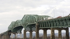 The Champlain Bridge spans the Saint Lawerence river in Montreal, Friday, March 18, 2011. (The CANADIAN PRESS/Graham Hughes)