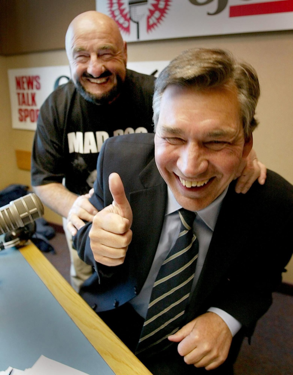 Former wrestler Maurice Mad Dog Vachon, left, was Premier Gary Doer's special guest while the Premier was the guest host on a local radio program in Winnipeg on Tuesday Jan. 29, 2002. Mad Dog will be honoured wednesday evening at the Franco Manitoba Cultural Center by Manitoba wrestling fans for his contribution to the entertainment. (CP PHOTO/Winnipeg Free Press-Joe Bryksa)