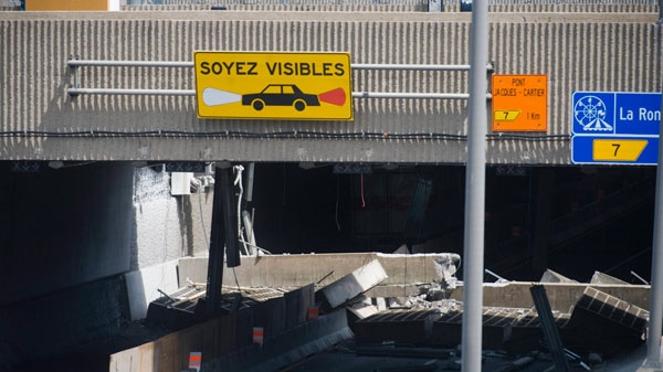 A section of an overpass is shown after it collapsed in Montreal Sunday, July 31, 2011. (Graham Hughes / THE CANADIAN PRESS)