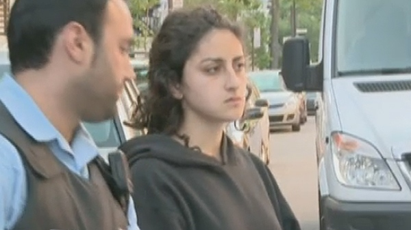 Yalda Machouf-Khadir is placed into a squad car after being arrested for vandalism in spring 2012.